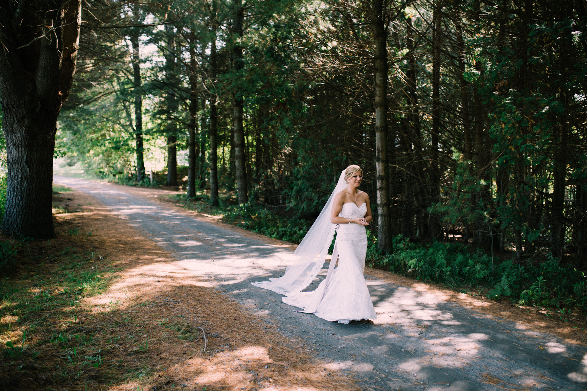 bride walking on a path for first look