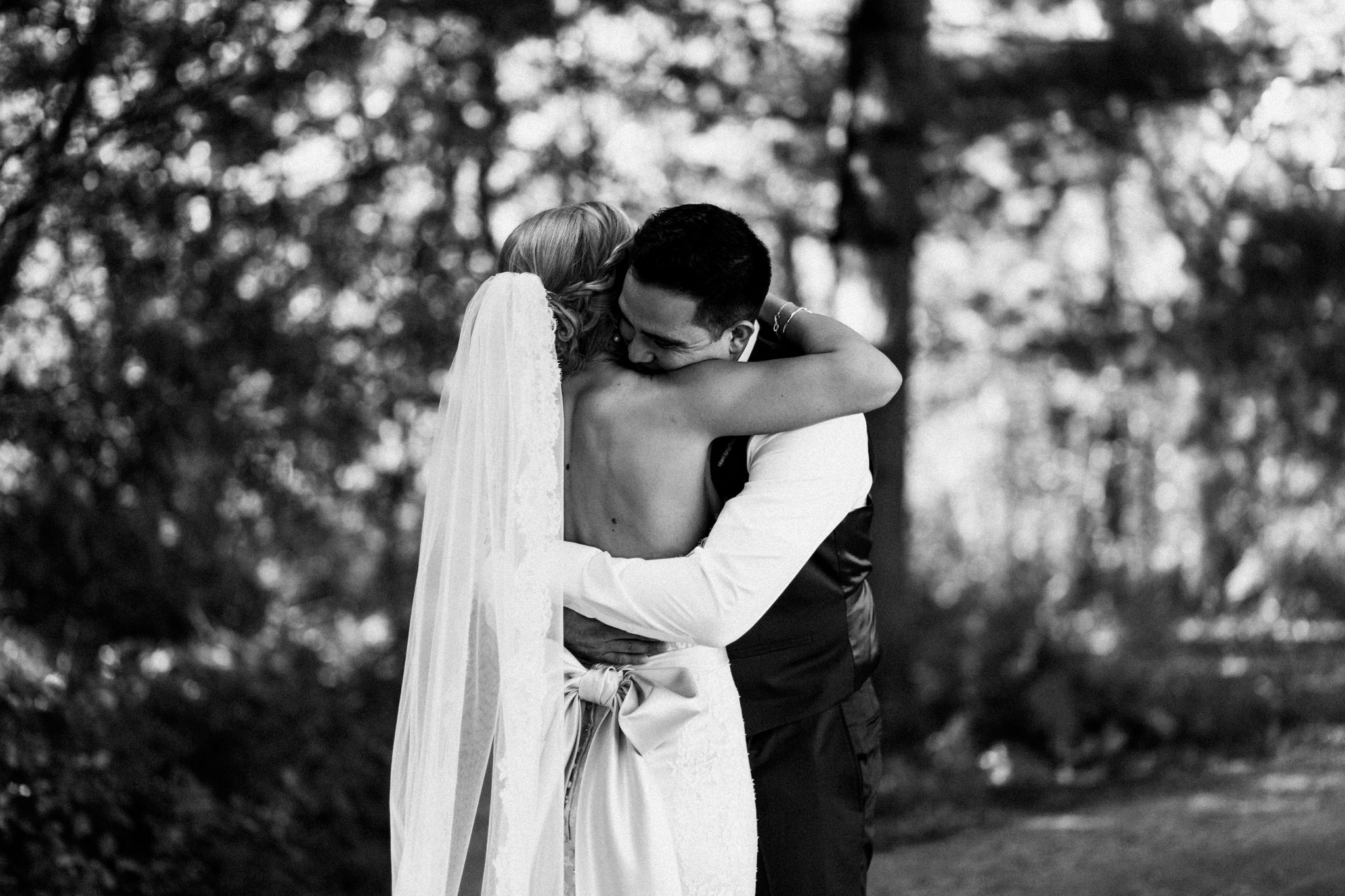 bride and groom embracing during first look