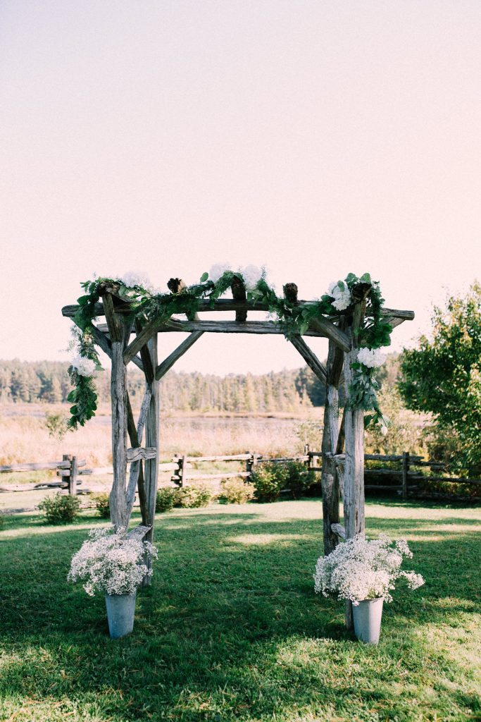 wooden wedding arch at brooklands farms