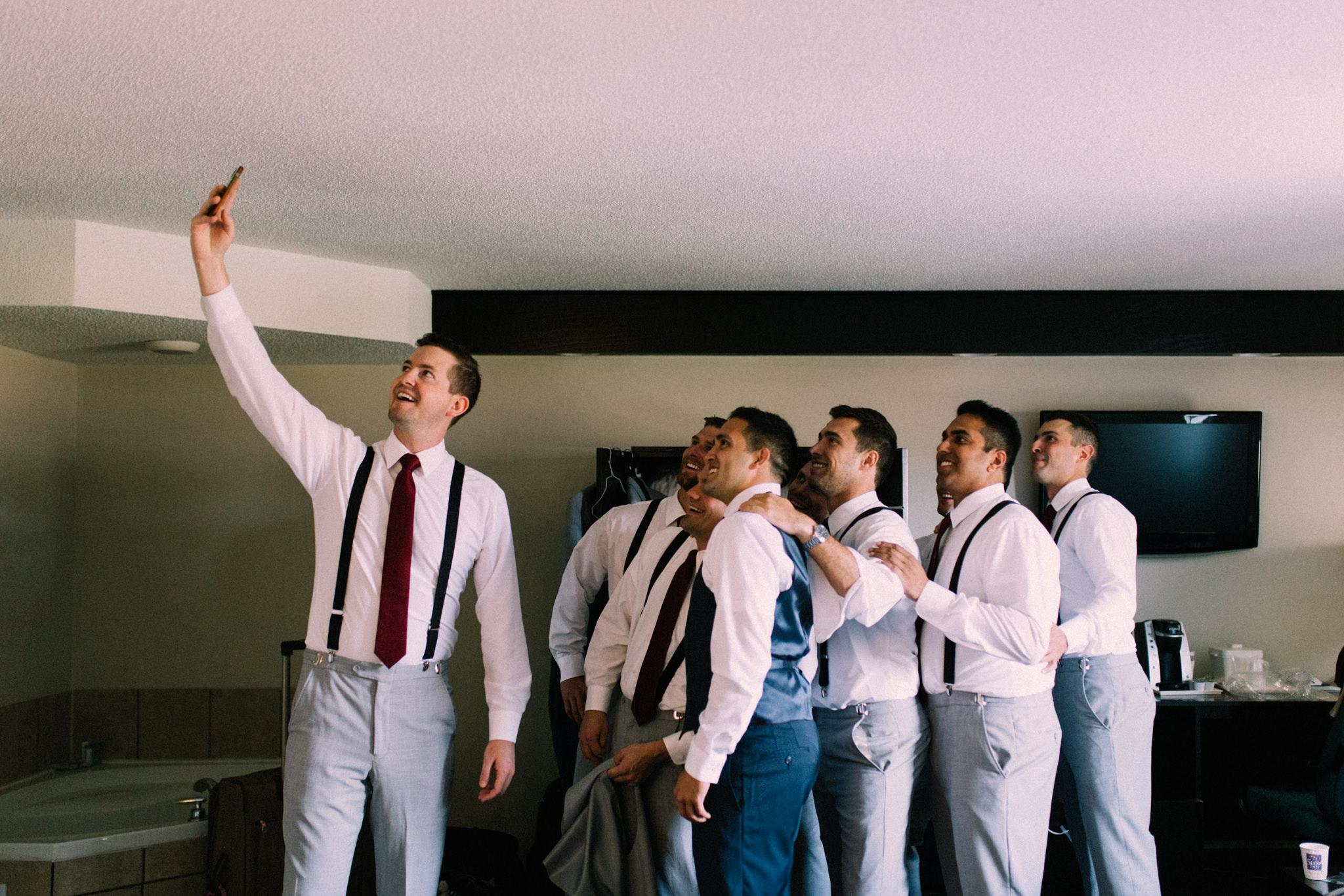 groomsmen posing for a selfie