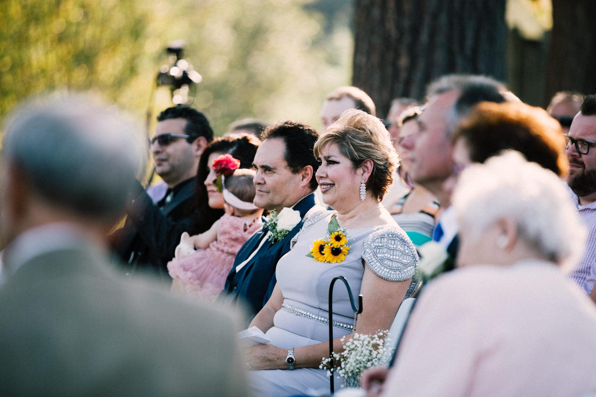mom looking lovingly at groom