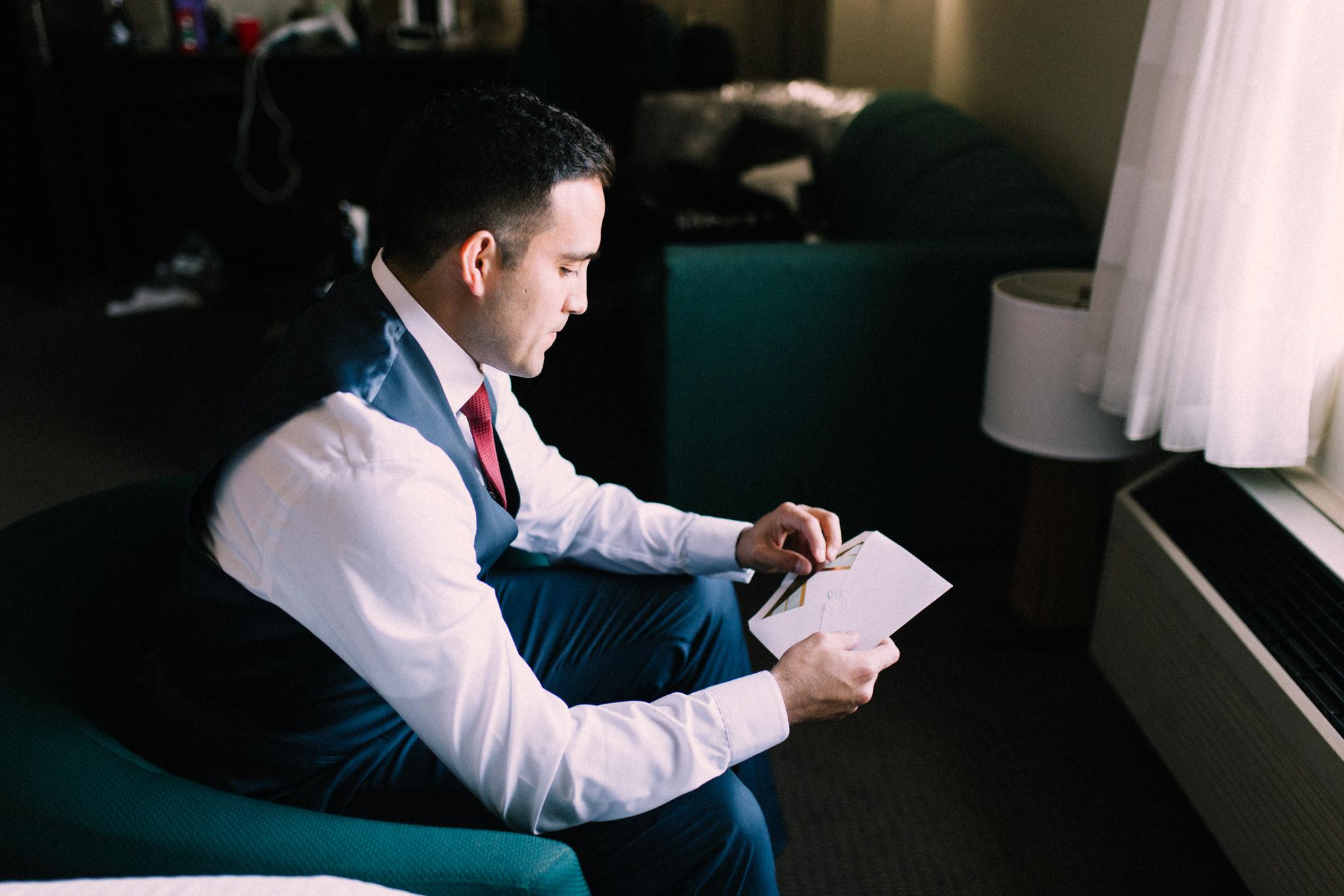 groom reading letter from bride