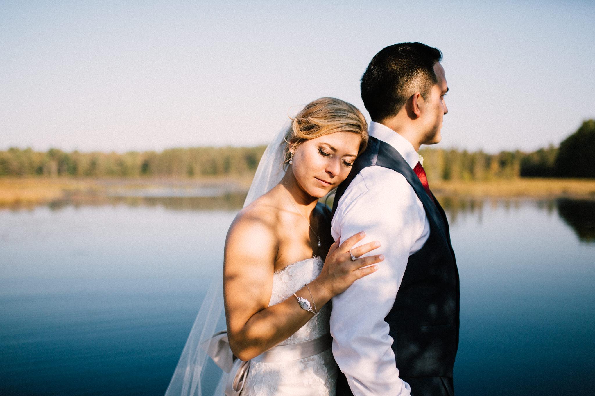 bride resting on grooms shoulders