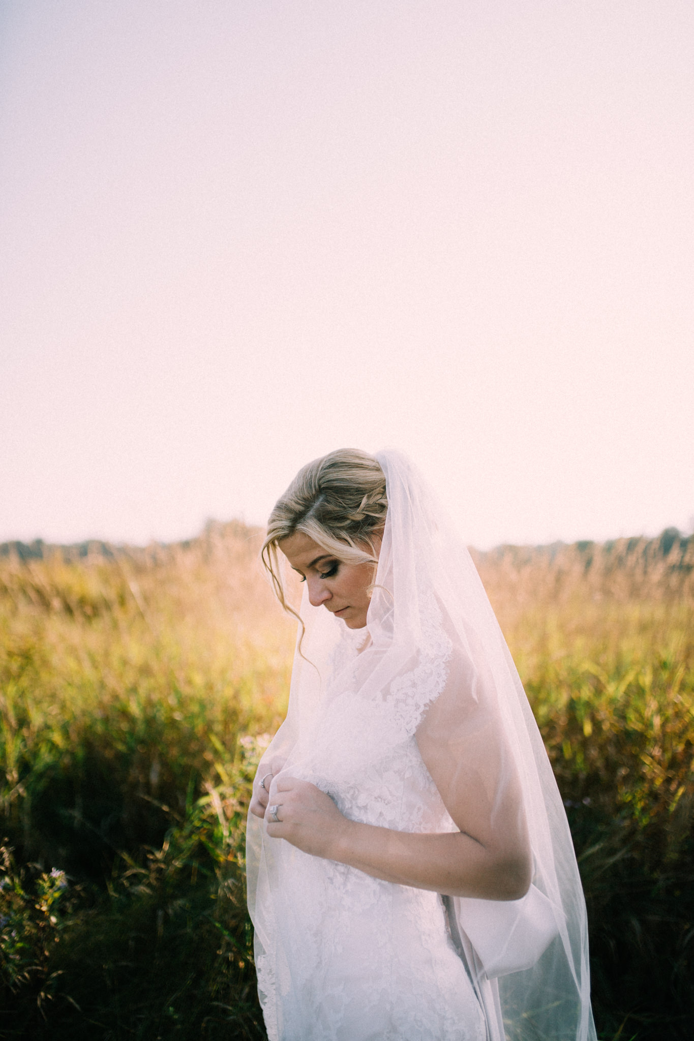 bride portrait in a field during sunset
