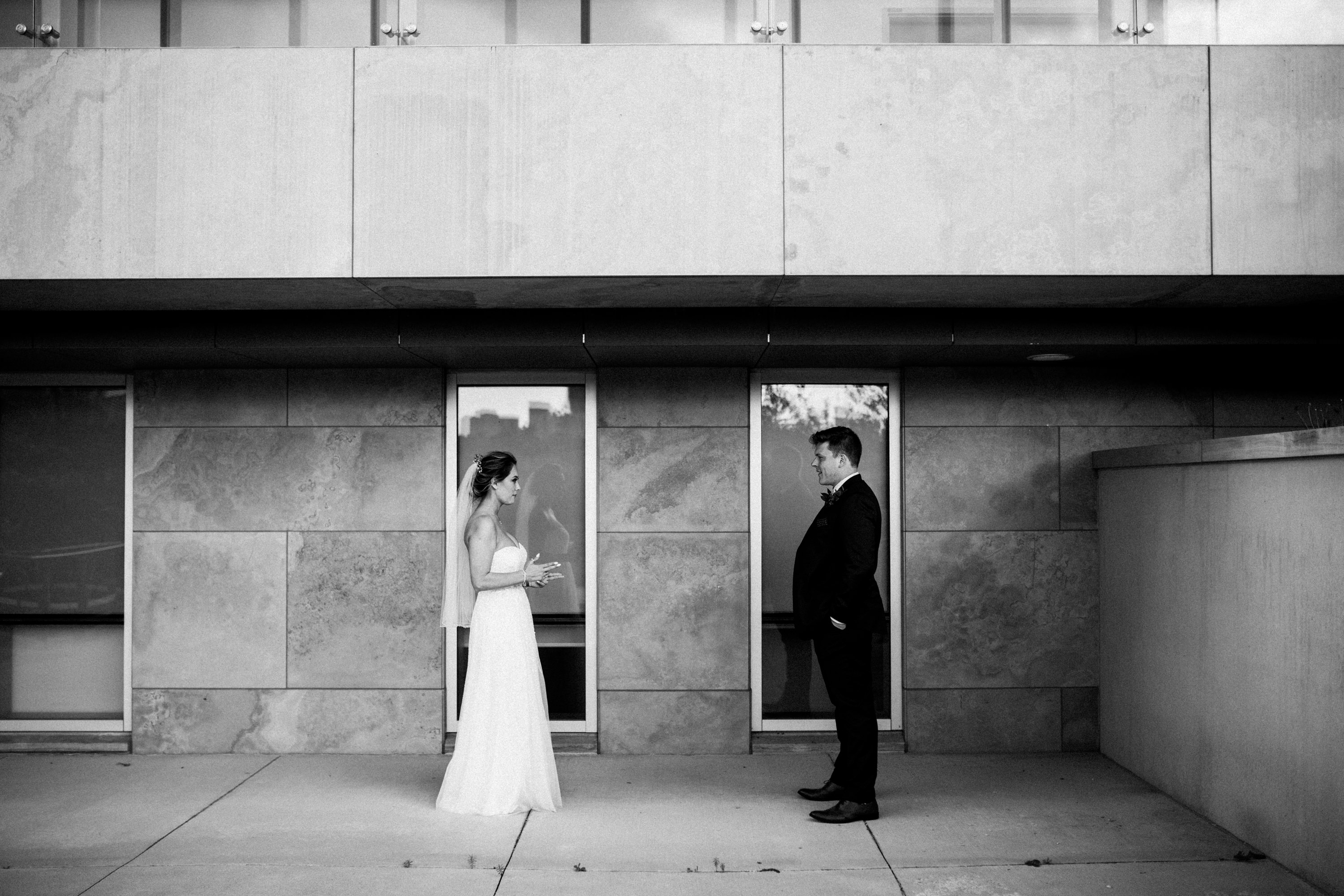bride and groom standing across from each other
