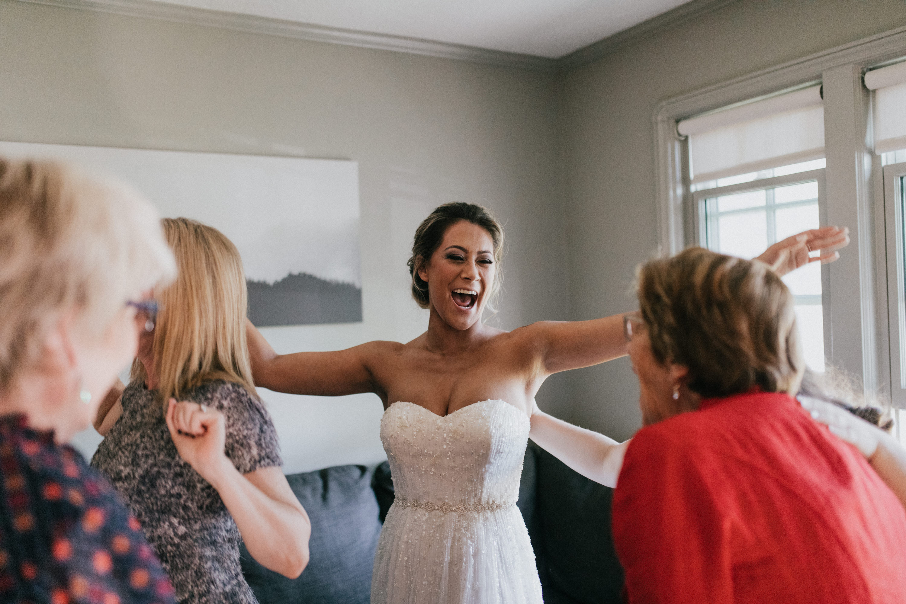 bride celebrating getting into dress