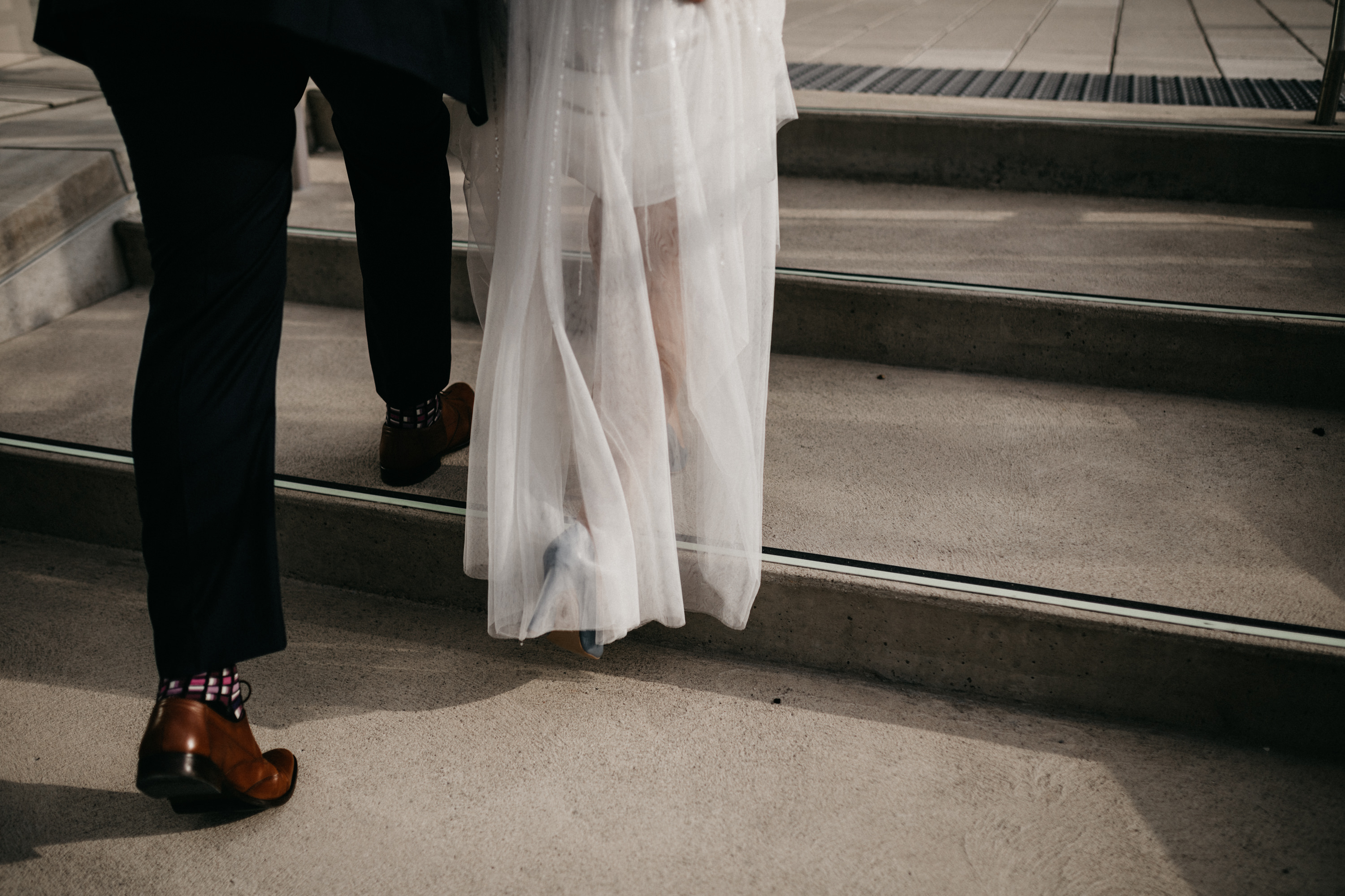 bride and groom feet walking together