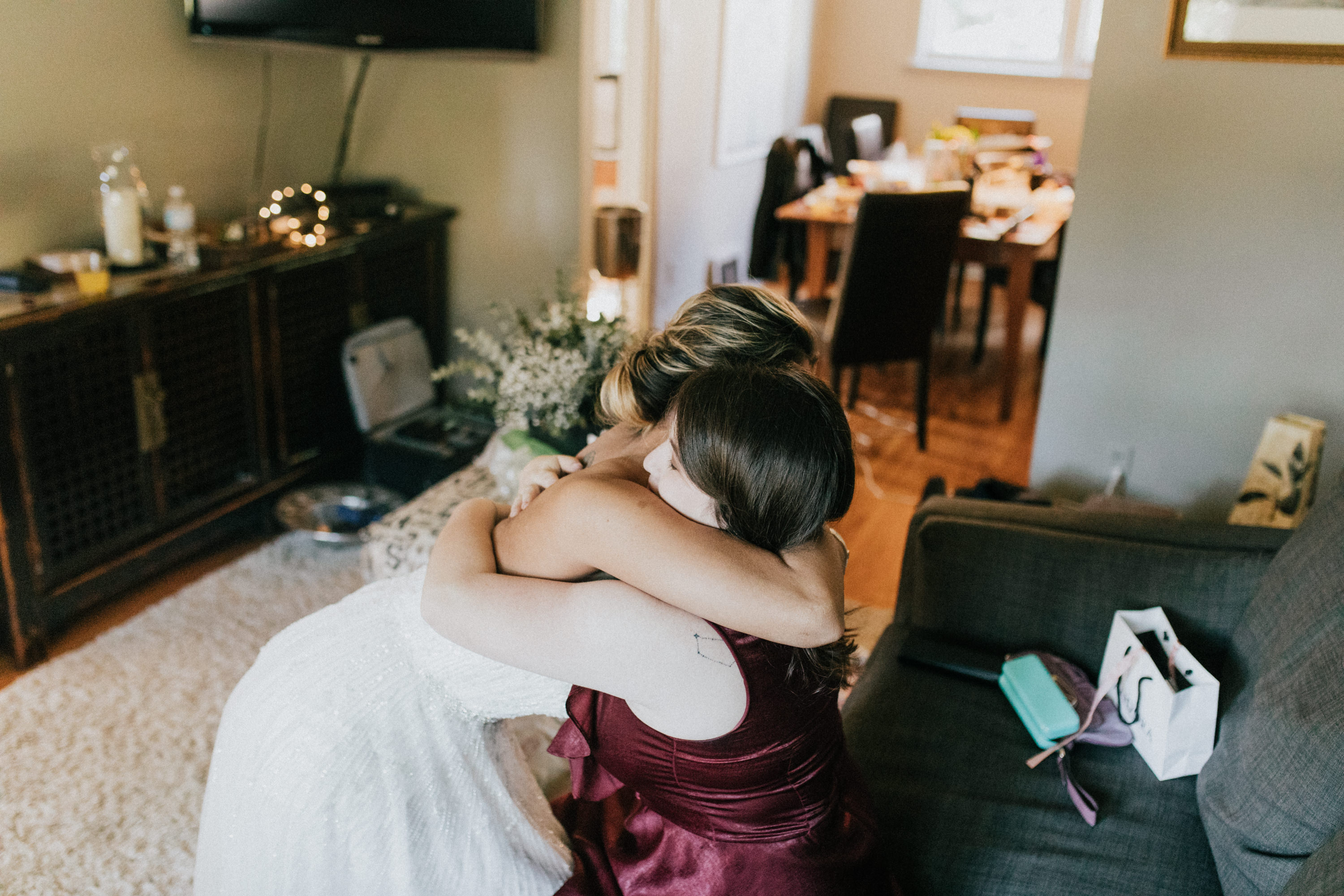 bride hugging sister