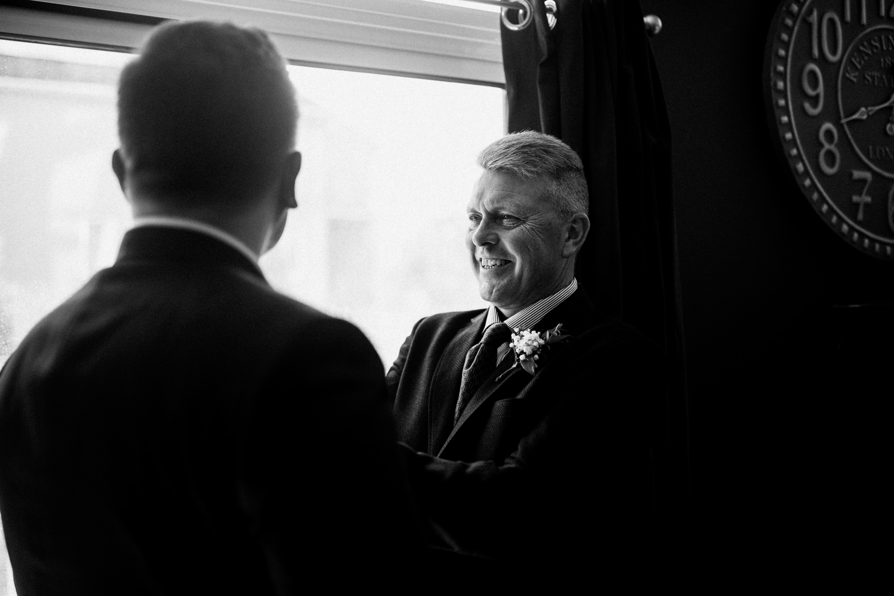 proud father looking at groom