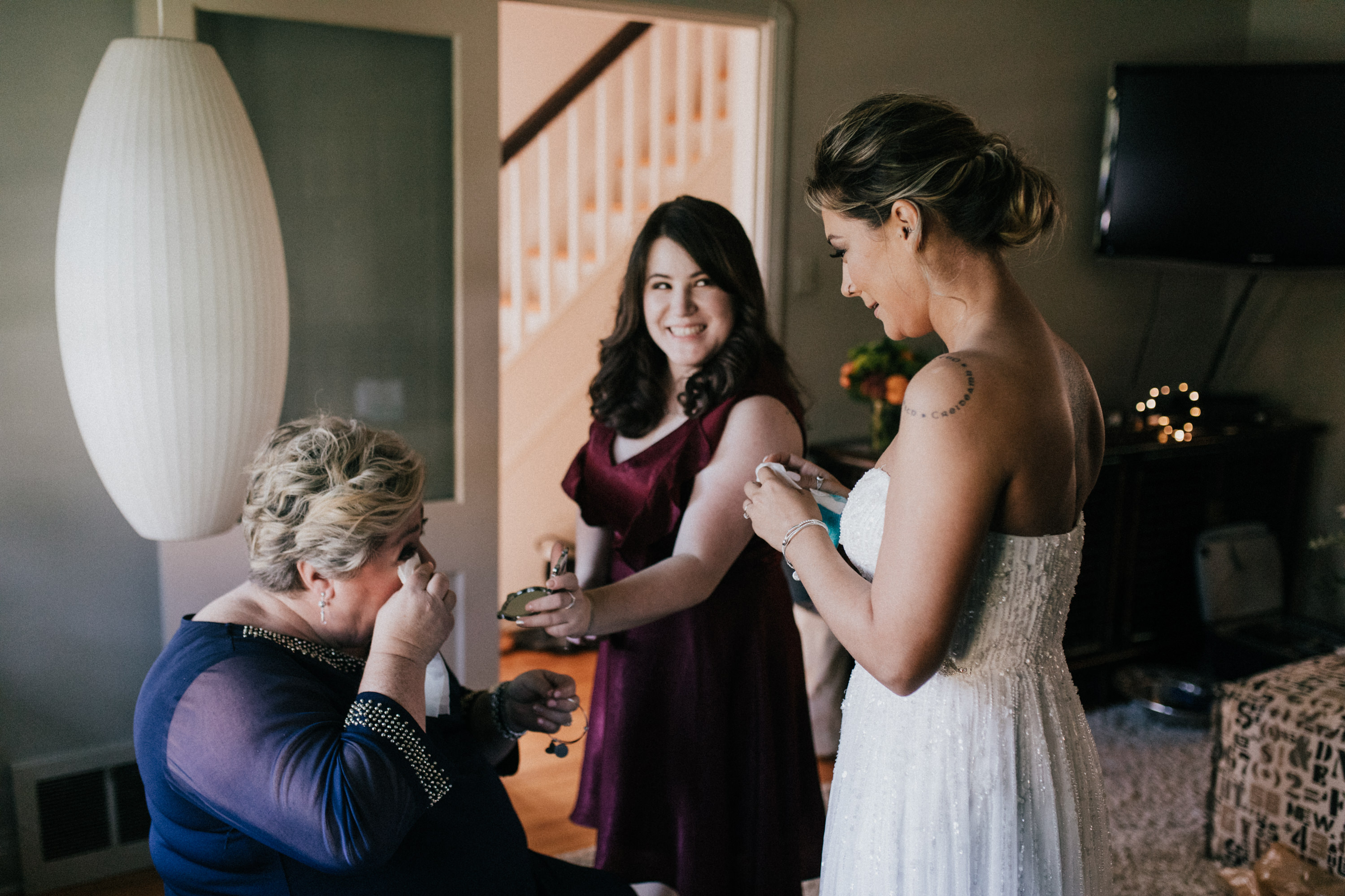 mom crying receiving gift from bride