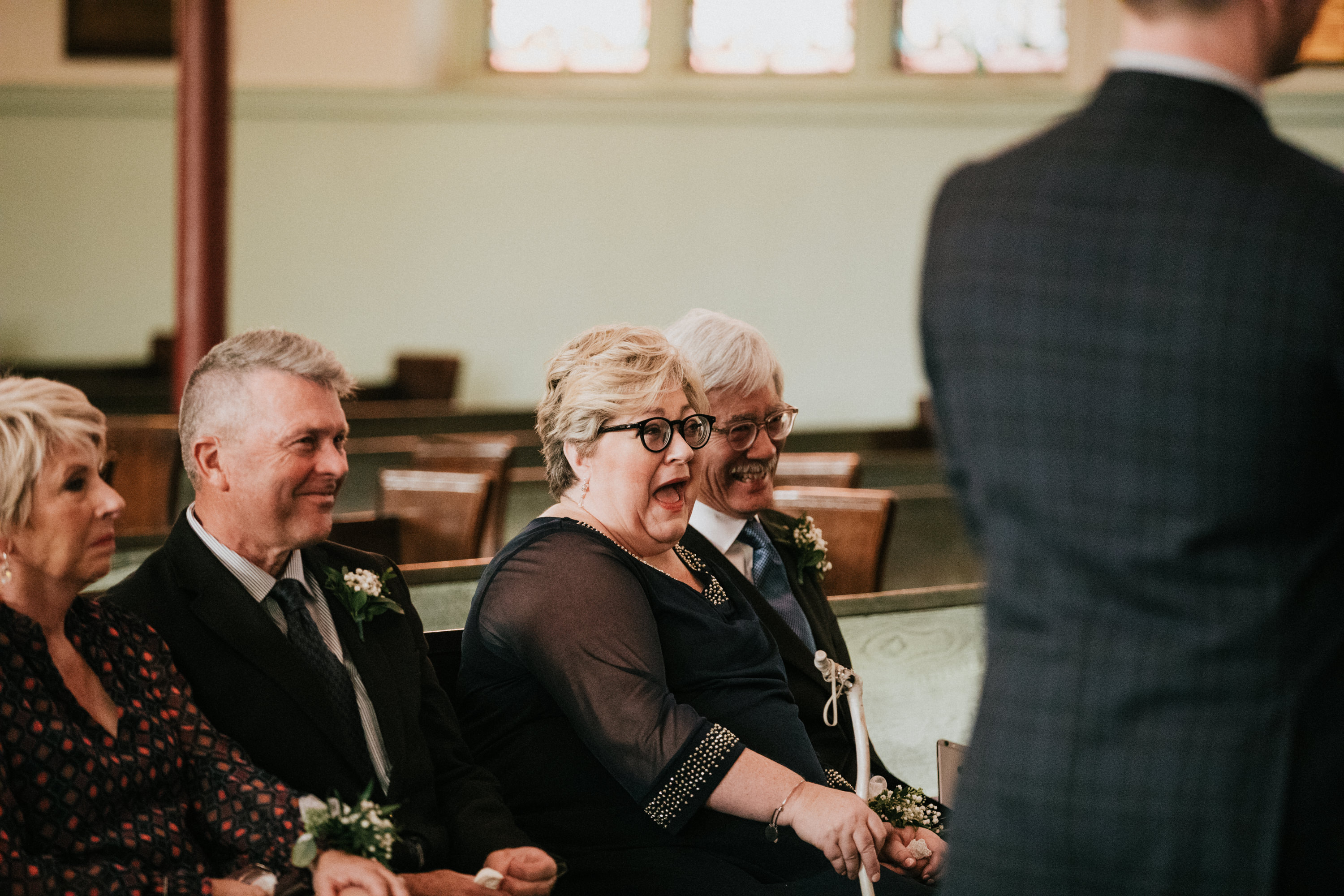 mom laughing at ceremony