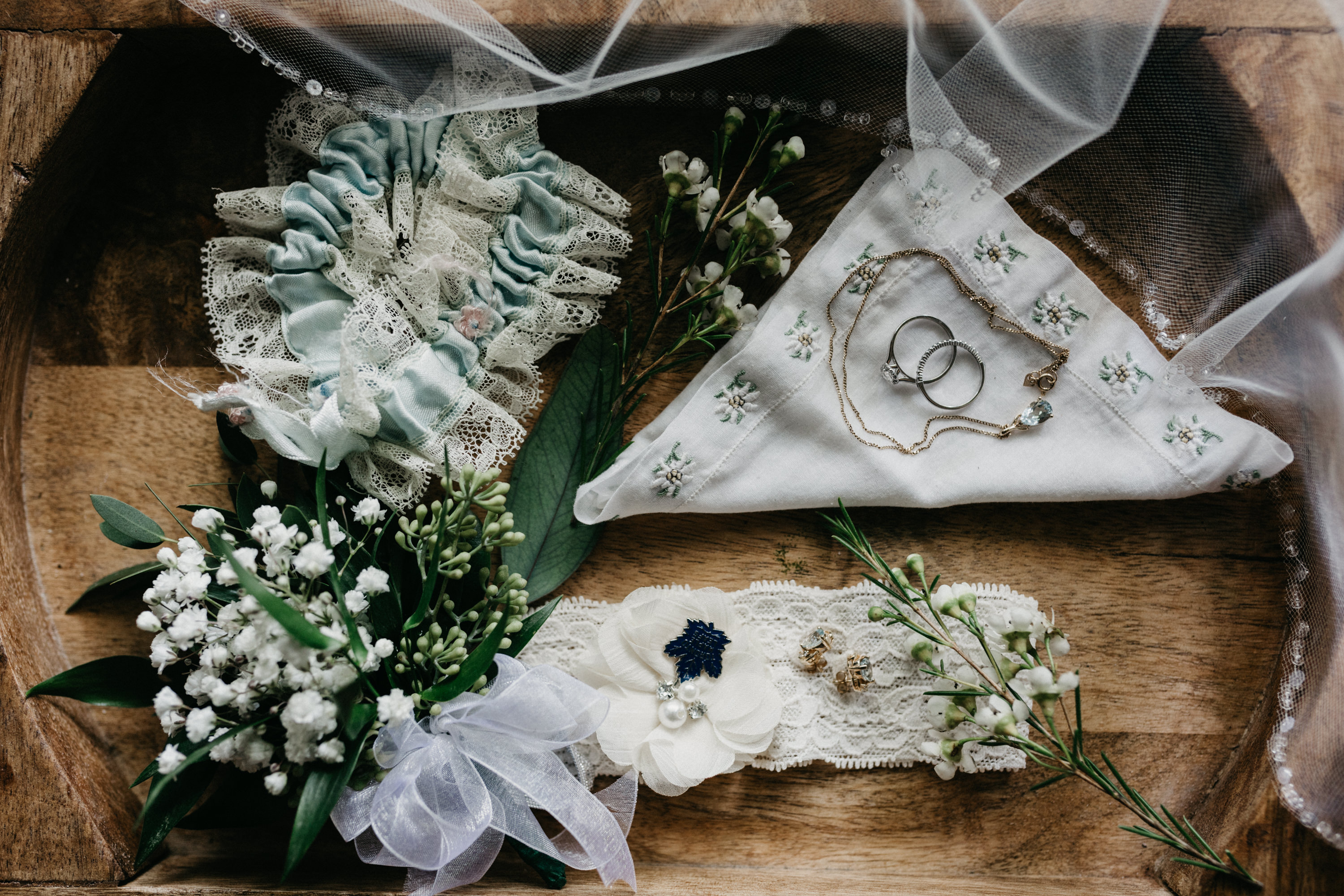 wedding details flatlay garter