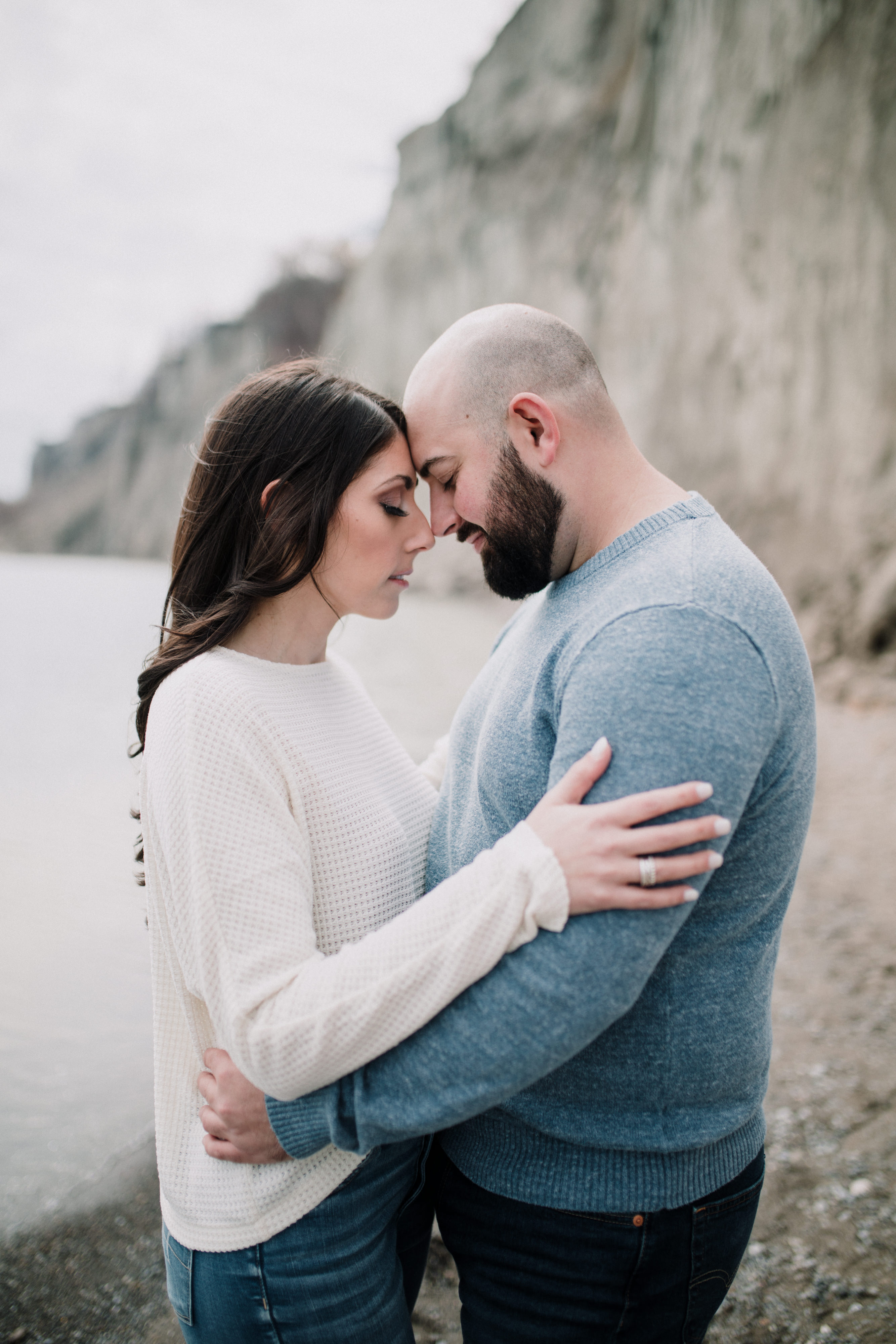 engaged couple holding each other face to face during a spring engagement shoot