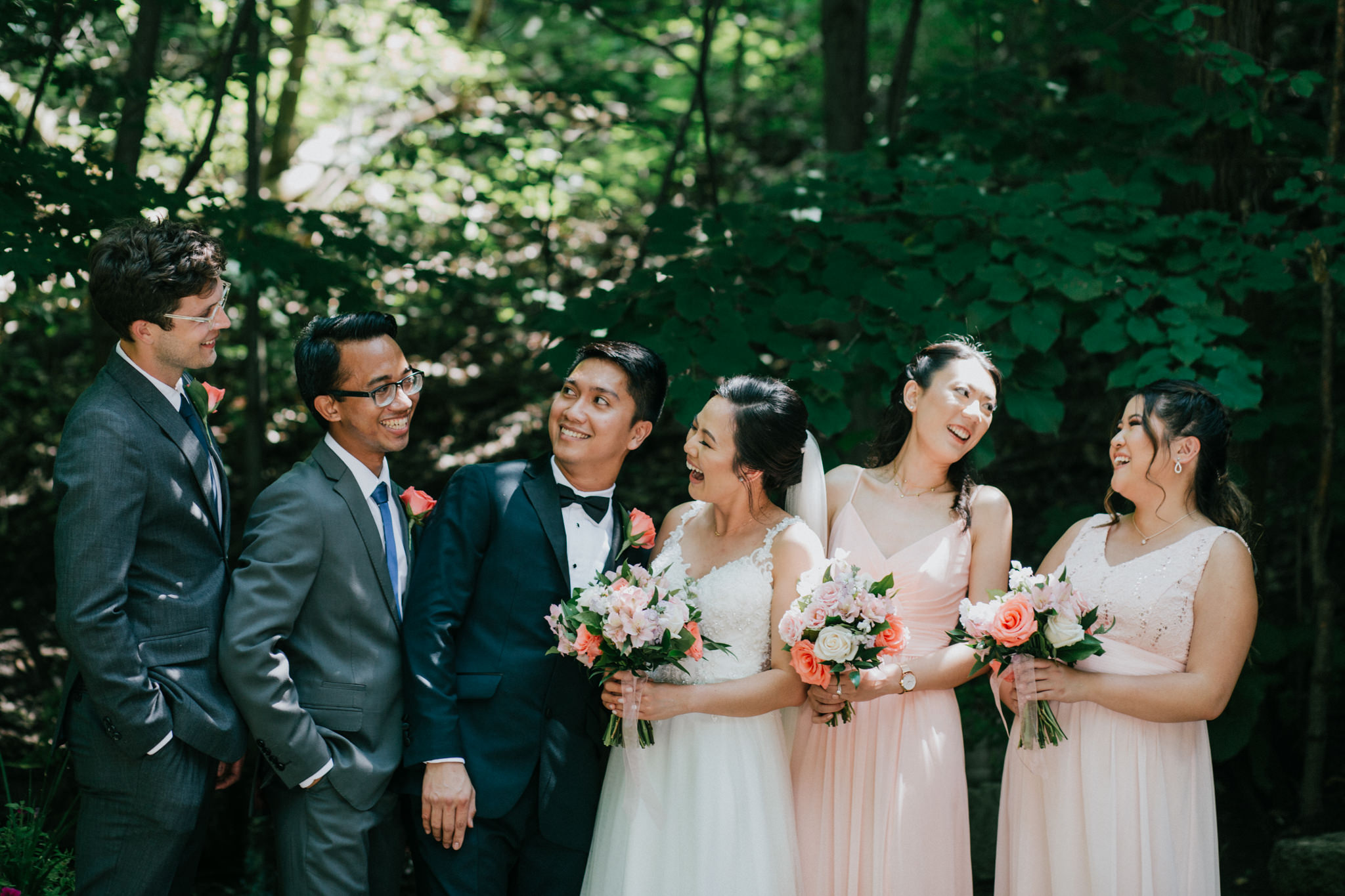 bridal party laughing at each other