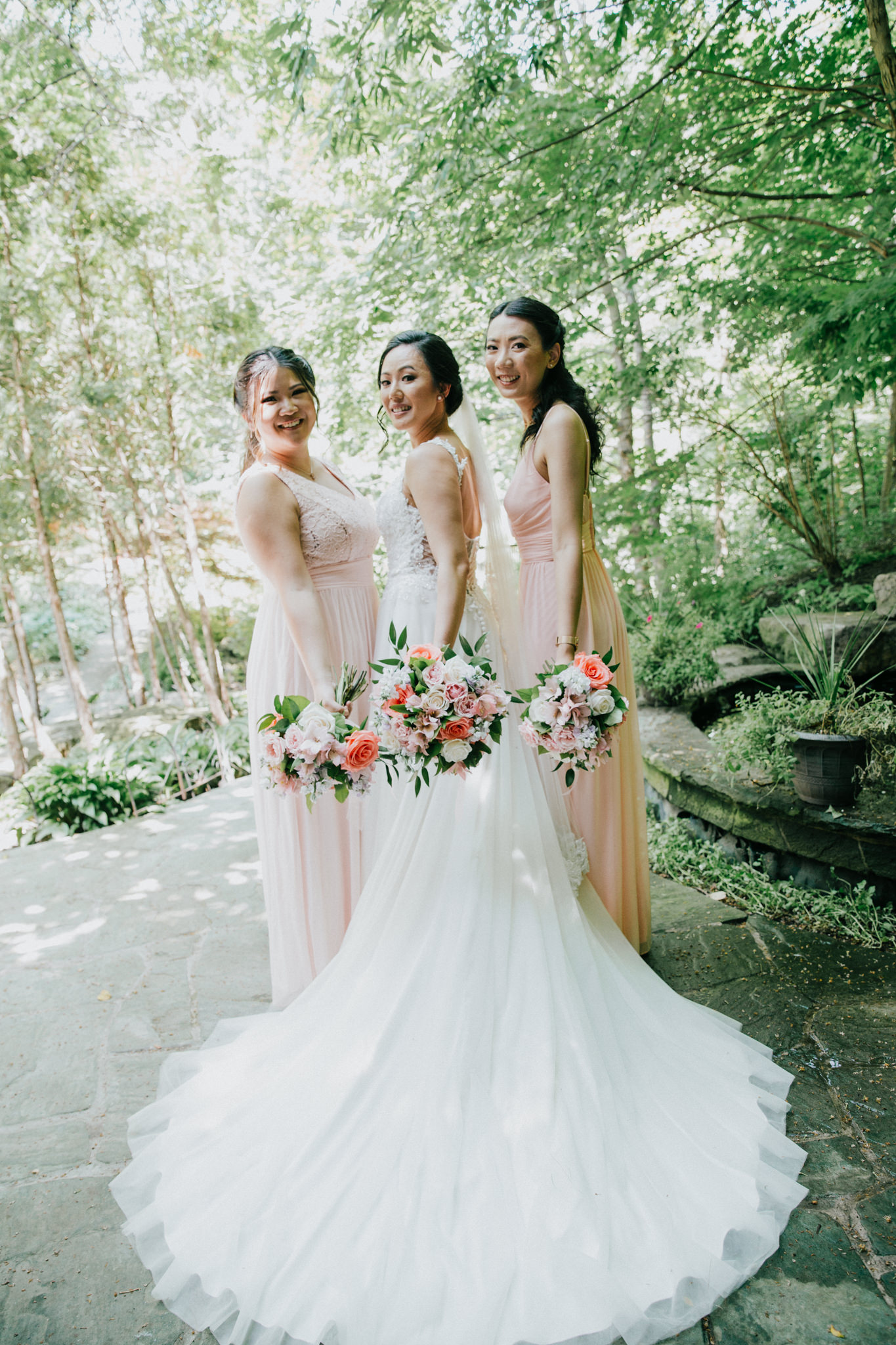 bride and bridesmaids posing for a photo