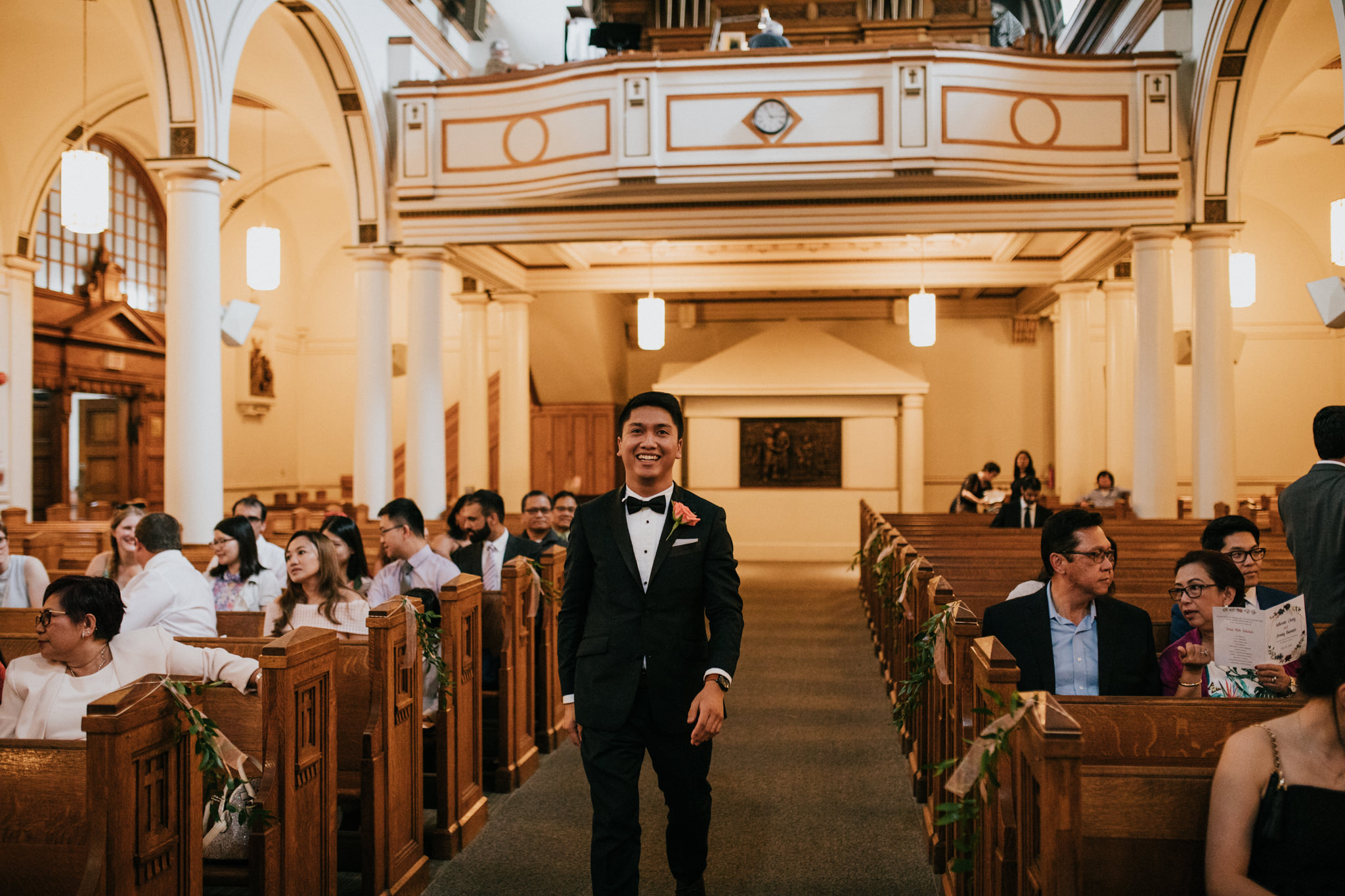 groom walking down the aisle in a church