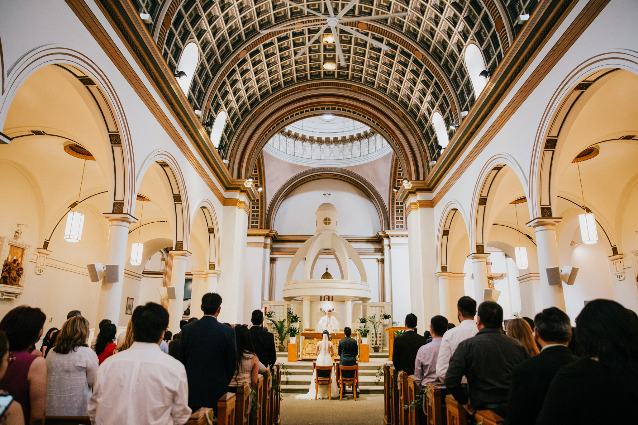 wide angle shot of bride and groom in a church