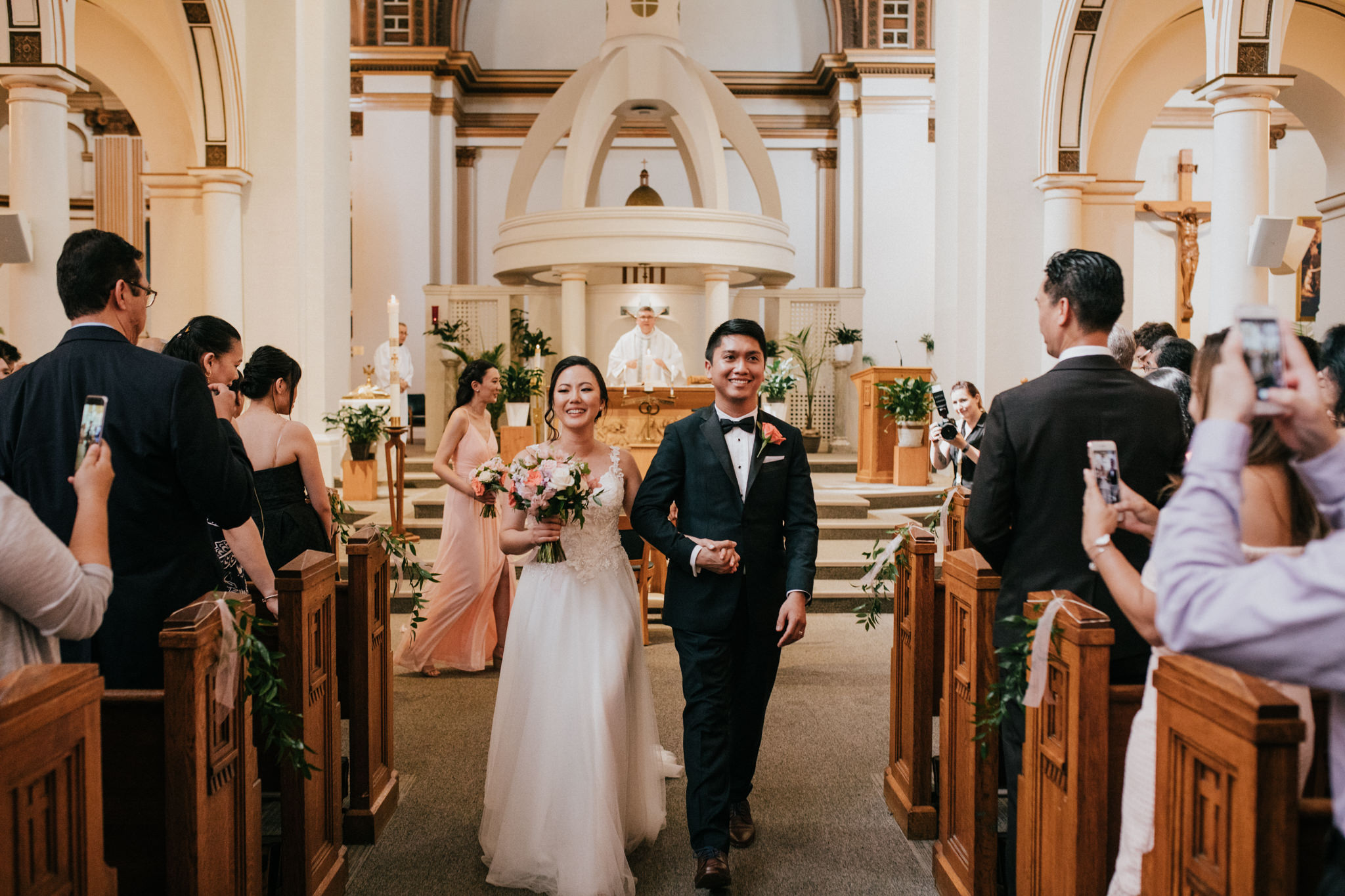 bride and groom walking down the aisle during recessional