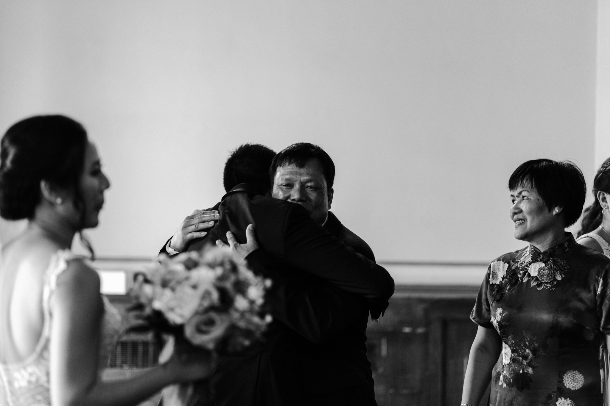 groom hugging dad