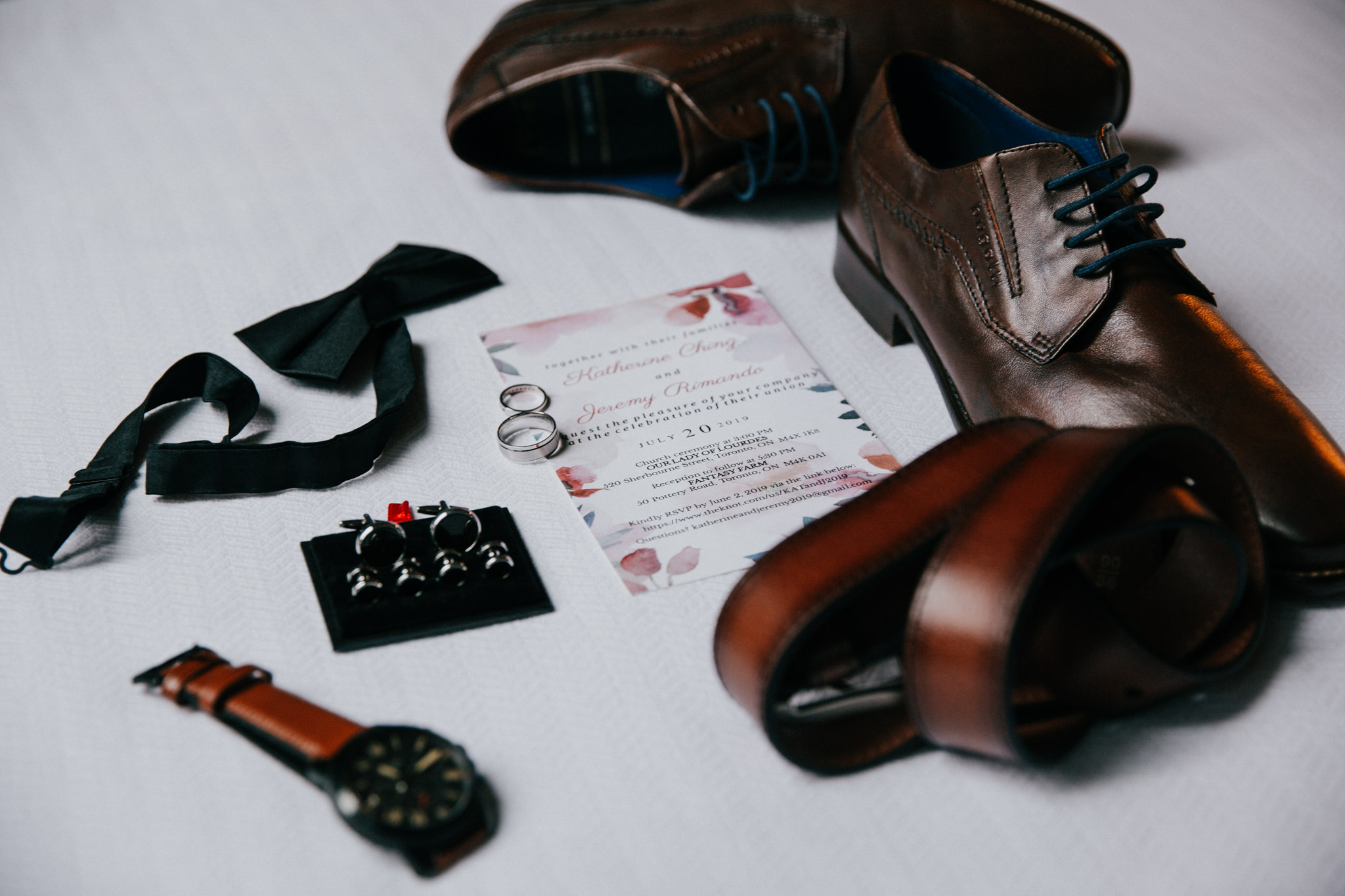 flatlay of groom accessories