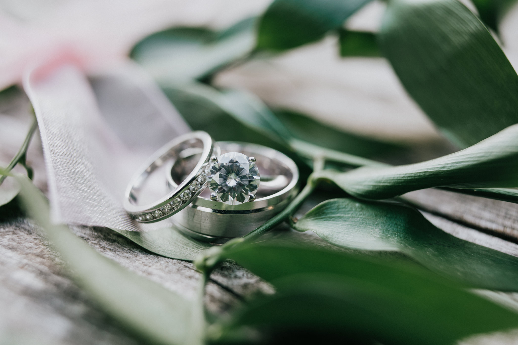 close up of wedding ring on leaf