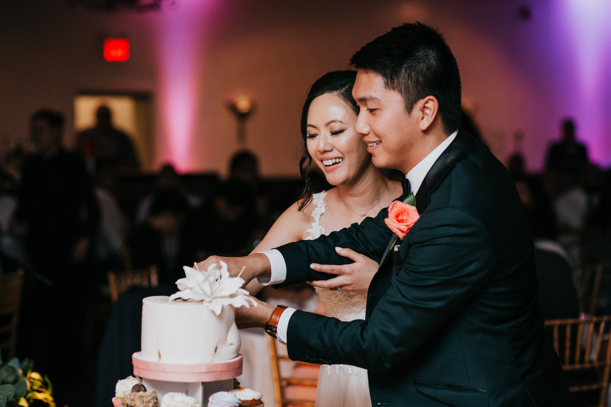 bride and groom cutting a wedding cake together